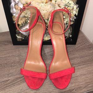 Red velvet pumps